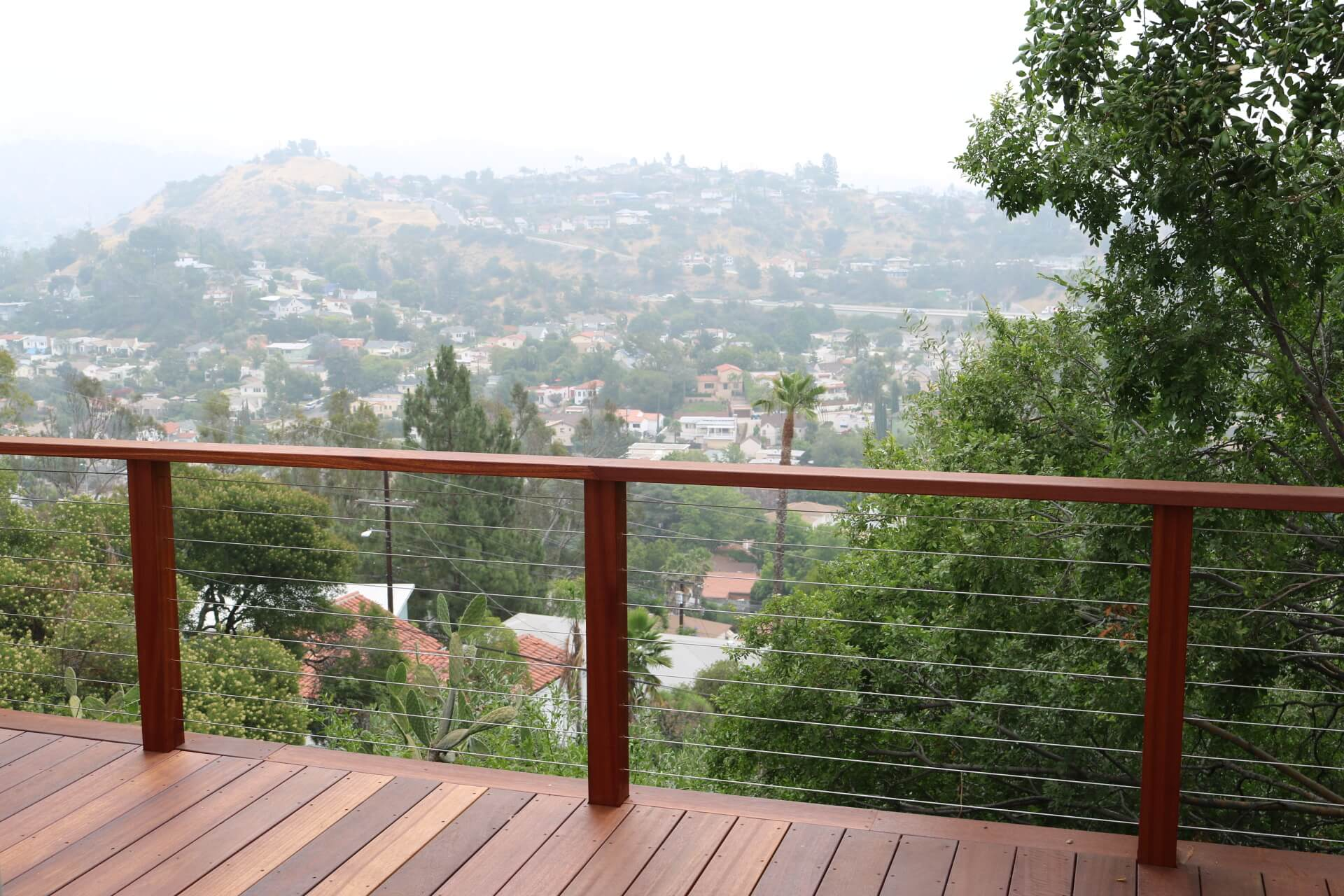 Wooden Deck Outlined By Steel Cable Railing